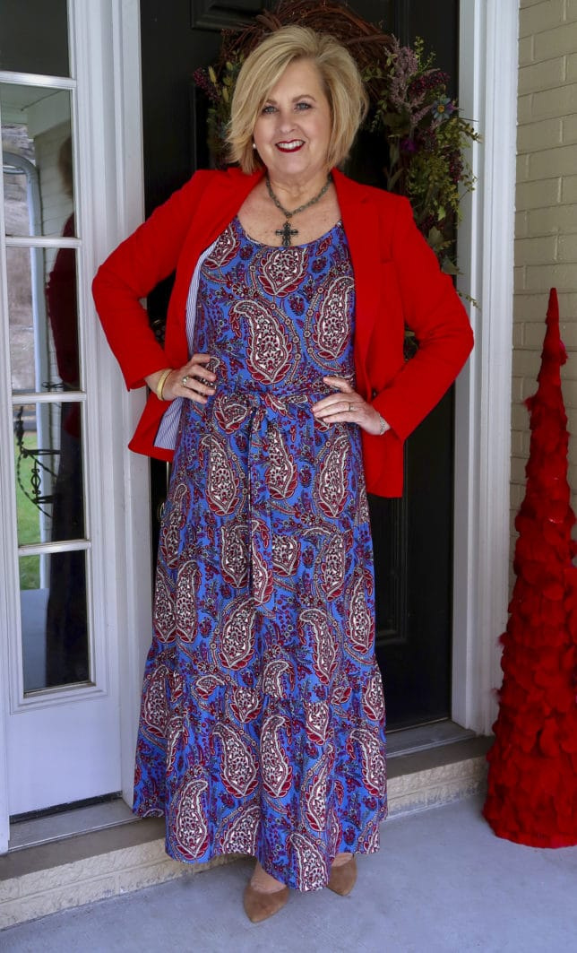 A bright apple red blazer and a paisley dress perfect for spring styled by Fashion Blogger 50 Is Not Old