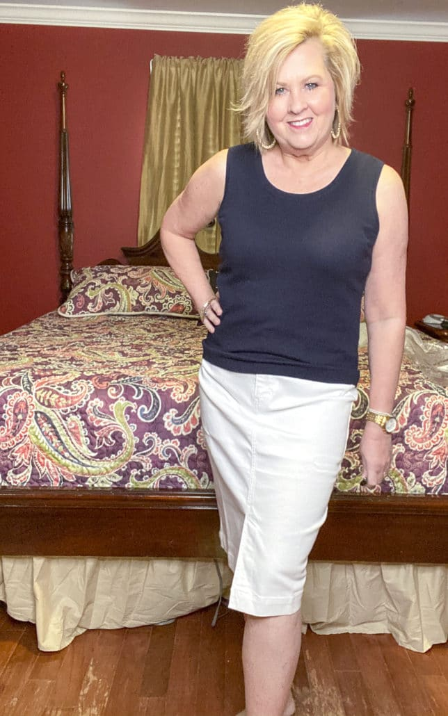 Fashion Blogger 50 Is Not Old wearing a navy top and a white pencil skirt