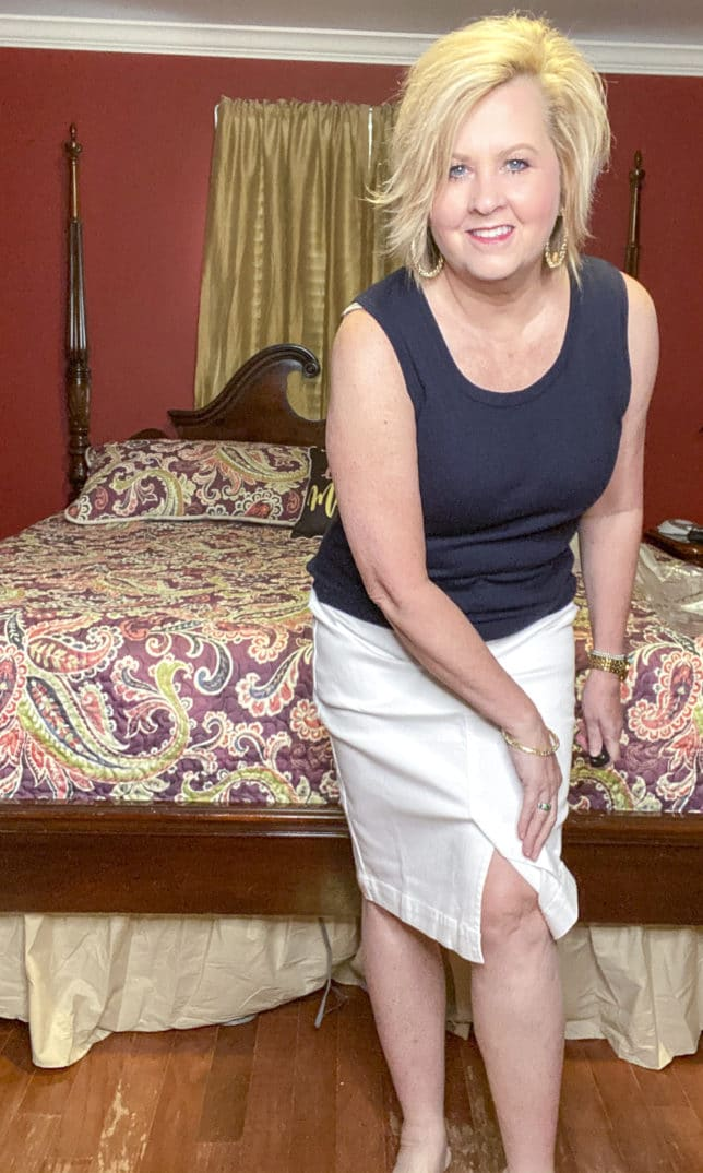 Fashion Blogger 50 Is Not Old wearing a white skirt and a navy top
