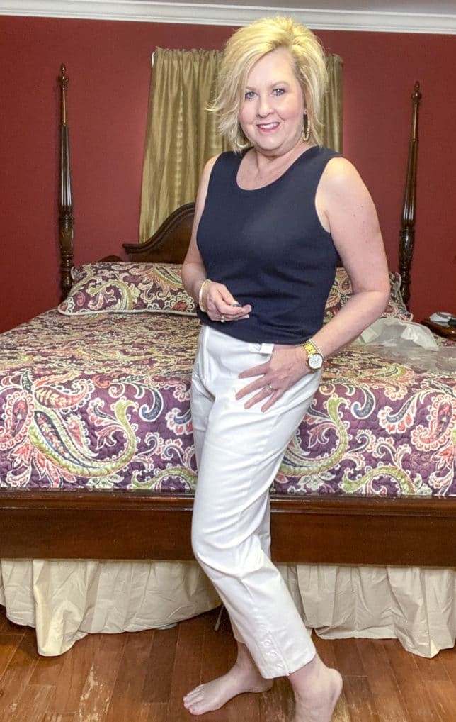 White crop pants and a navy top worn by blogger 50 Is Not Old