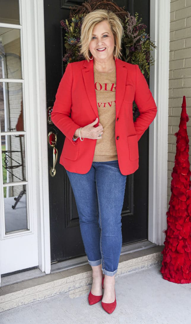Fashion Blogger 50 Is Not Old wearing a red blazer and a tan sweater from Talbots, and cuffed jeans and red pumps