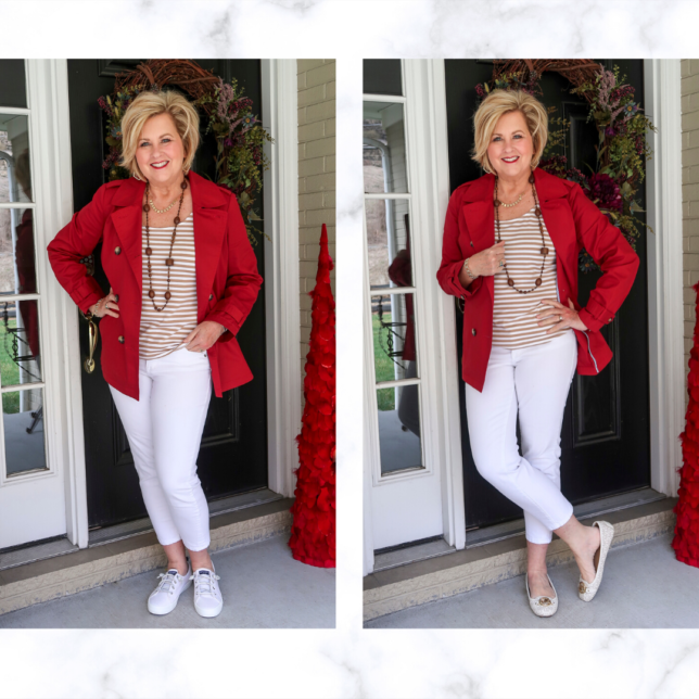 Fashion Blogger 50 Is Not Old is wearing a pair of white jeans with a tan striped top and a red trench coat with two different pair of shoes