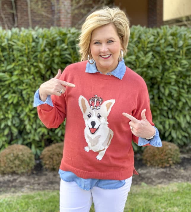 Fashion Blogger 50 Is Not Old is styling a coral sweater that has a Corgi dog on it from Walmart