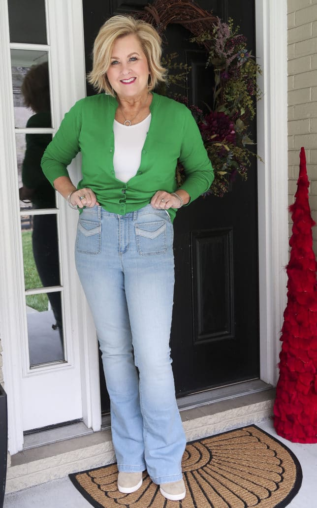 Fashion Blogger 50 Is Not Old is wearing a high waisted pair of faded flared jeans from Walmart