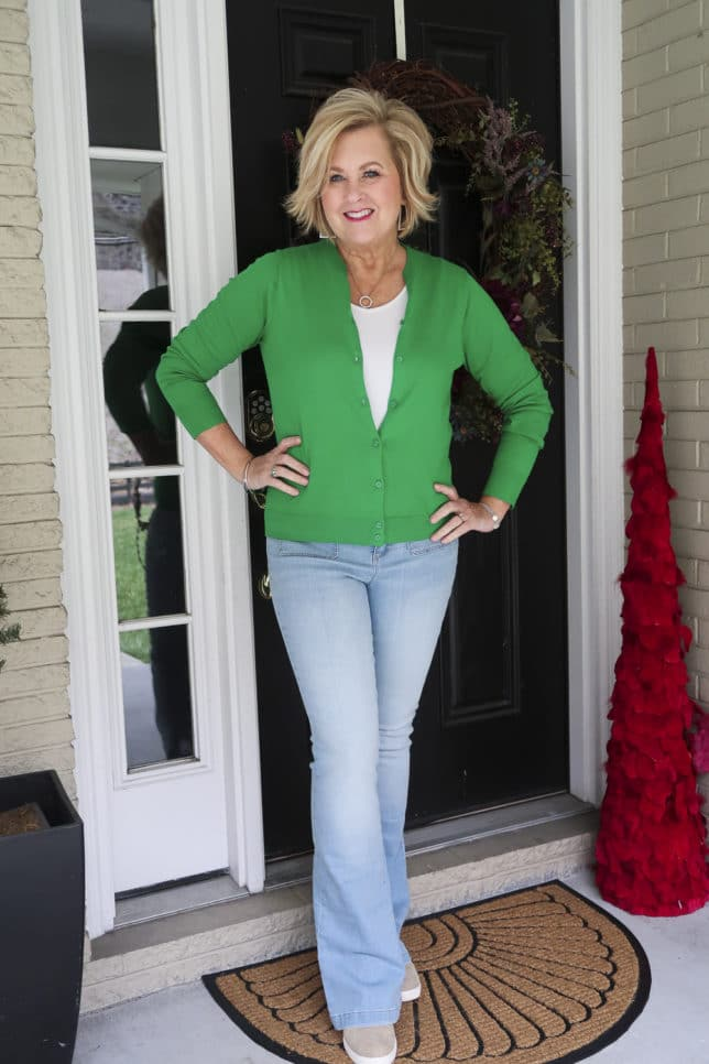 Fashion Blogger 50 Is Not Old is in the mood for spring with this Kelly Green cardigan from J.Crew Factory and flared jeans from Walmart