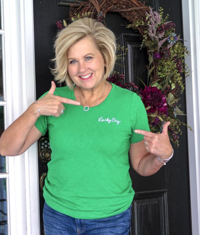 Fashion Blogger 50 Is Not Old wearing a bright green lucky day t-shirt perfect for St. Patrick's Day