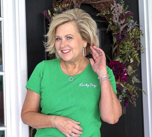 Fashion Blogger 50 Is Not Old wearing a bright green lucky day t-shirt wearing silver jewelry