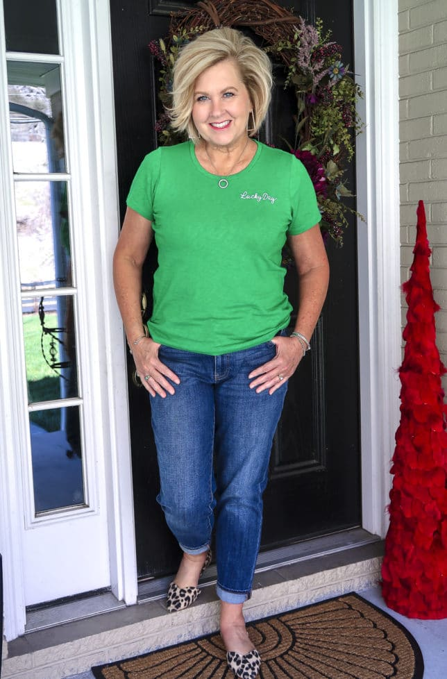 Fashion Blogger 50 Is Not Old wearing a bright green lucky day t-shirt and boyfriend jeans from Talbots with leopard print flats