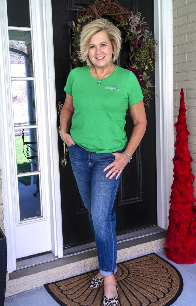 Fashion Blogger 50 Is Not Old wearing a bright green lucky day t-shirt and boyfriend jeans