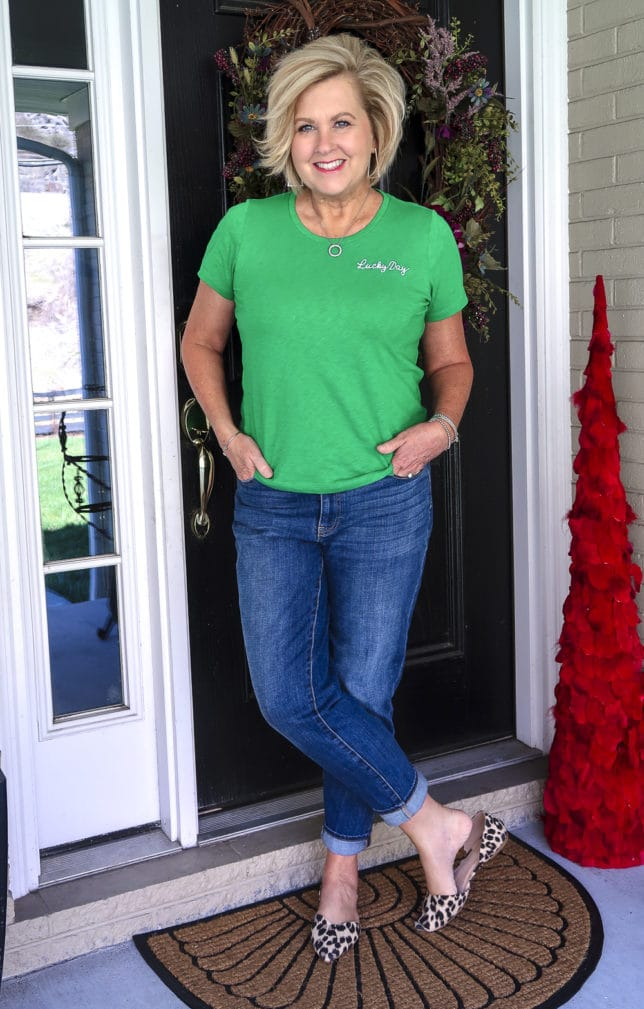 Fashion Blogger 50 Is Not Old wearing a bright green lucky day t-shirt and boyfriend jeans with leopard print flats