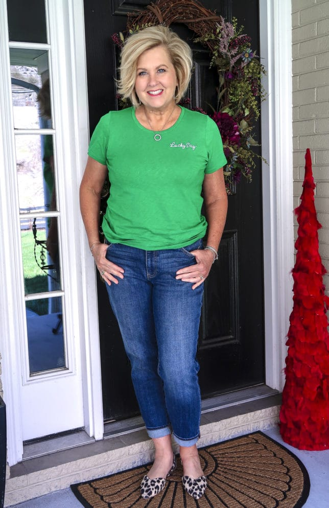 Fashion Blogger 50 Is Not Old wearing a bright green lucky day t-shirt and boyfriend jeans with leopard print flats from Old Navy