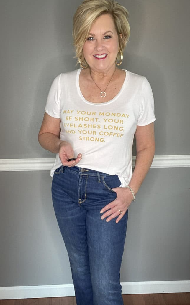 Fashion Blogger 50 Is Not Old in a white t-shirt with gold writing and jeans
