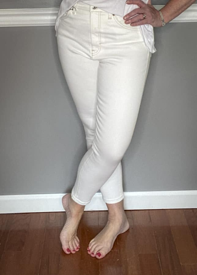 Fashion Blogger 50 Is Not Old in a pair of cream colored jeans