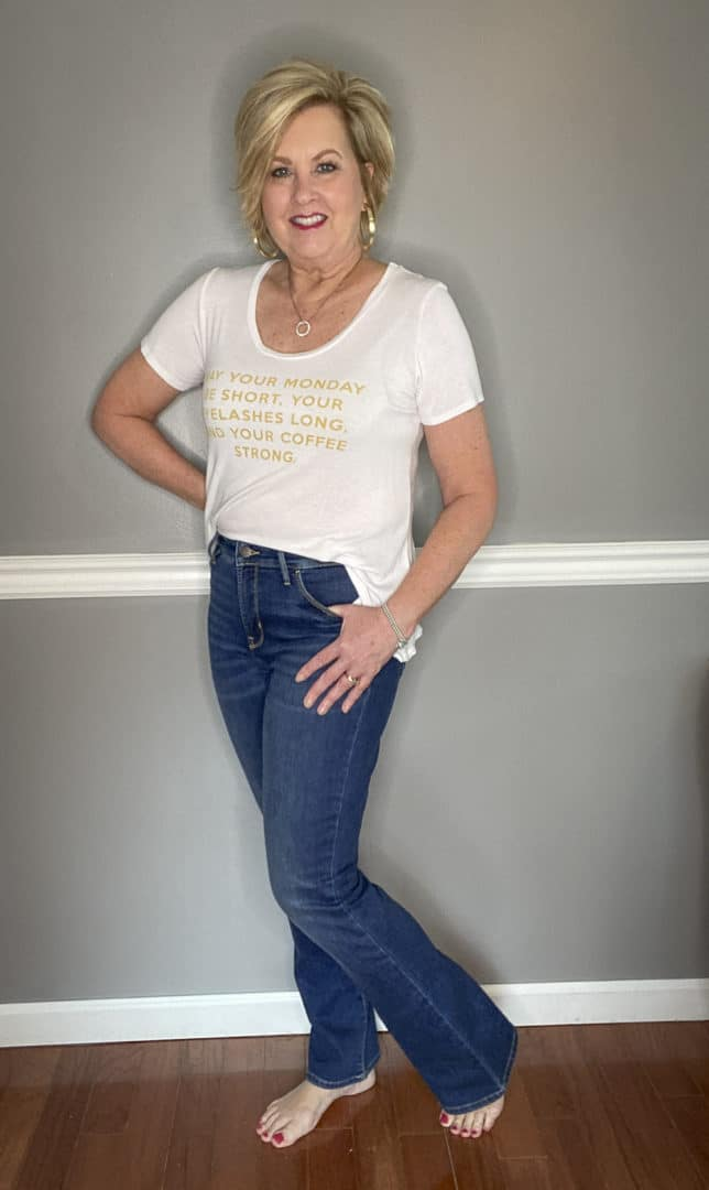 Fashion Blogger 50 Is Not Old in a white t-shirt and jeans
