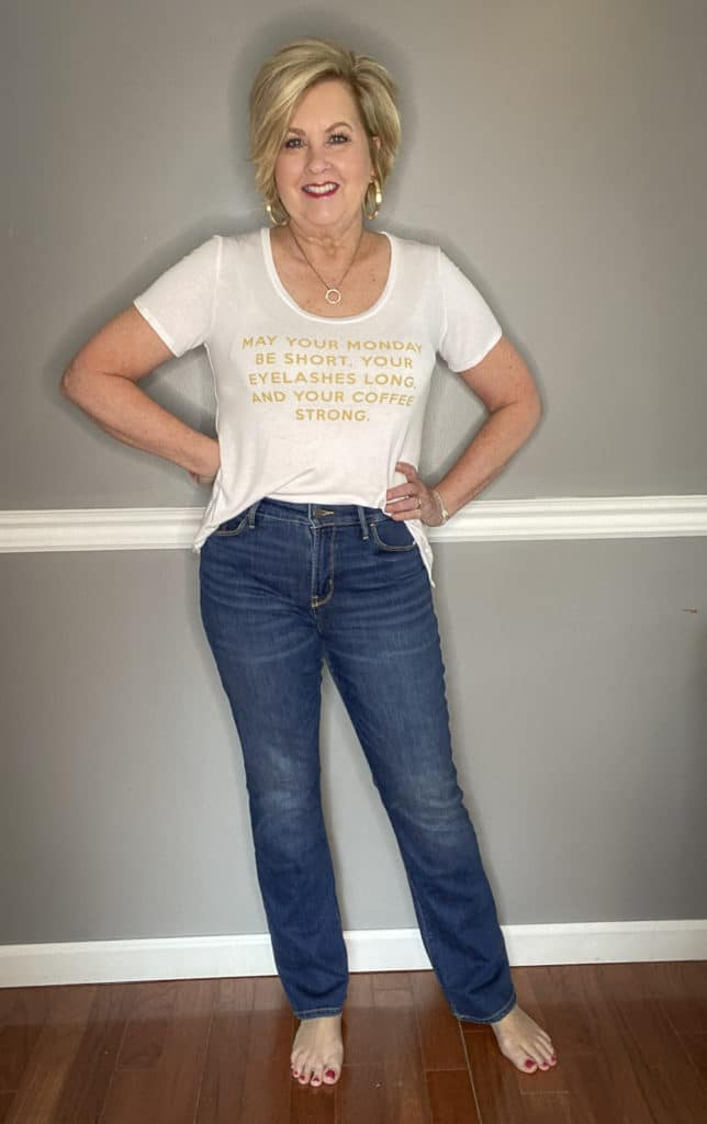 Fashion Blogger 50 Is Not Old wearing a white t-shirt with gold writing and jeans