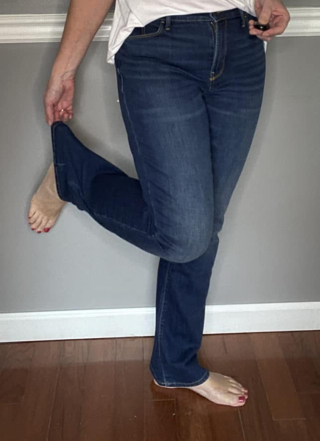 Fashion Blogger 50 Is Not Old in a pair of bootcut jeans