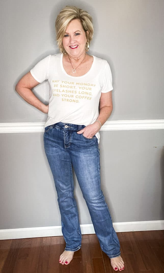 Fashion Blogger 50 Is Not Old in a white t-shirt with gold writing and vintage style jeans