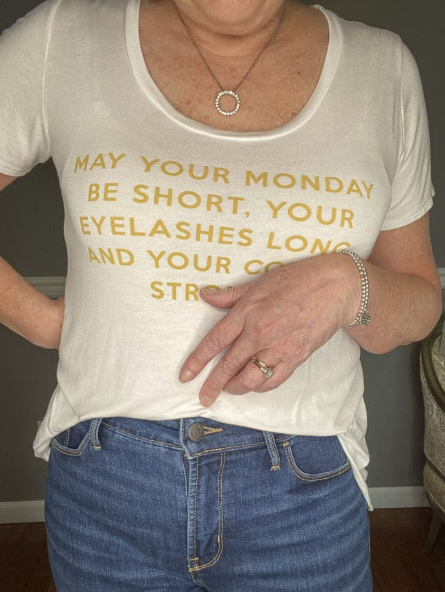 Fashion Blogger 50 Is Not Old in a white t-shirt with gold writing