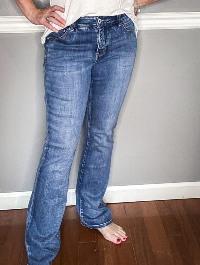 Fashion Blogger 50 Is Not Old in a pair of vintage style jeans