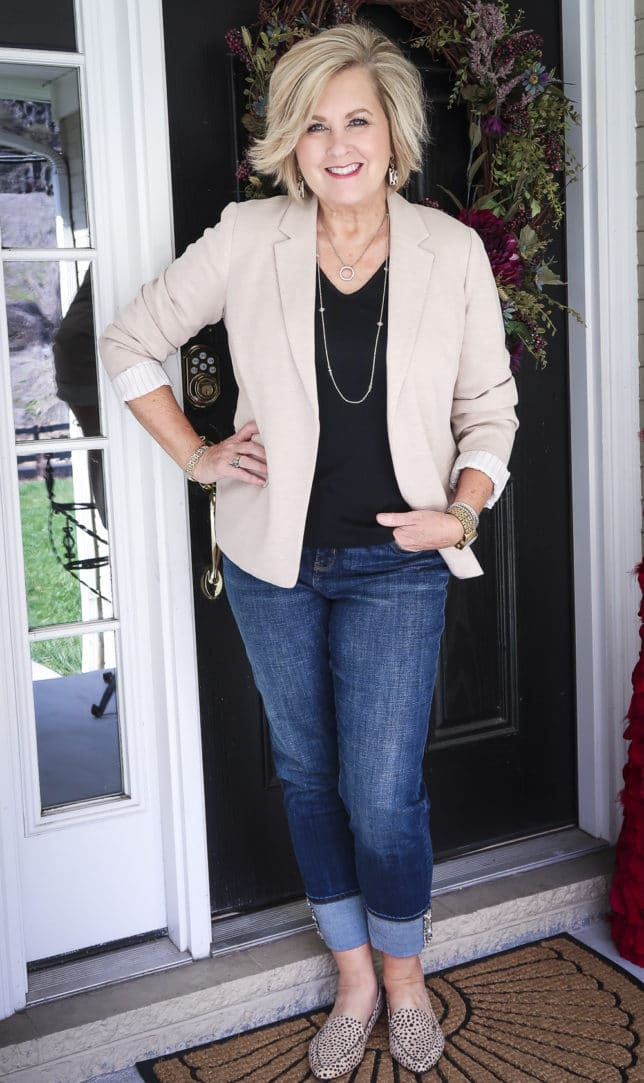 Fashion Blogger 50 Is Not Old in a taupe Ponte knit blazer, a black v-neck t-shirt, and cuffed jeans
