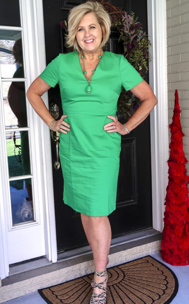 Fashion Blogger 50 Is Not Old is wearing a gorgeous bright green dress, zebra and cheetah print shoes, and a vintage green necklace
