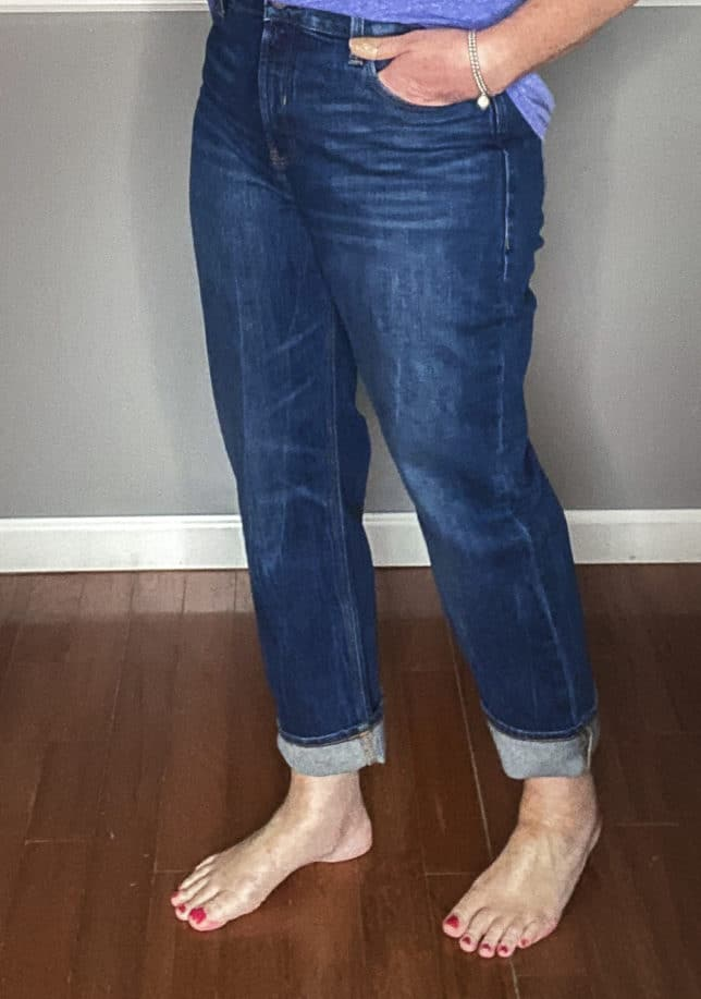 Fashion Blogger 50 Is Not Old showing a pair of boyfriend jeans with a cuff from Old Navy