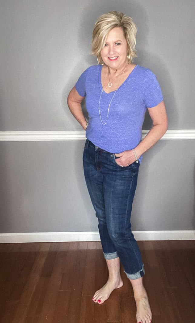 Fashion Blogger 50 Is Not Old wearing a pair of cuffed jeans from Kut From The Kloth and a blue v-neck t-shirt