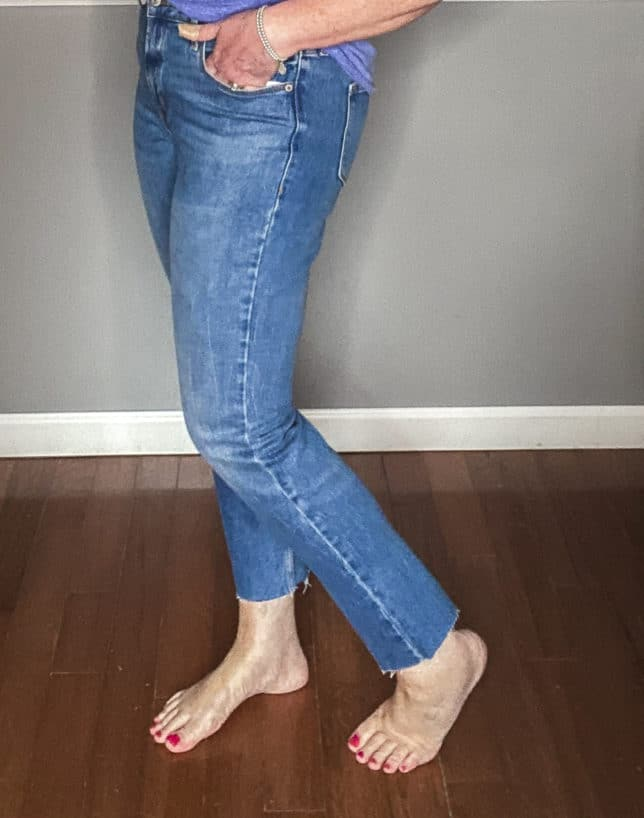 Fashion Blogger 50 Is Not Old wearing a pair of straight raw hem jeans from Old Navy