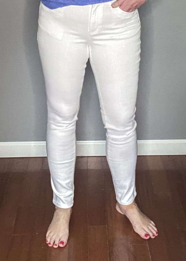 Fashion Blogger 50 Is Not Old wearing a pair of white jeans