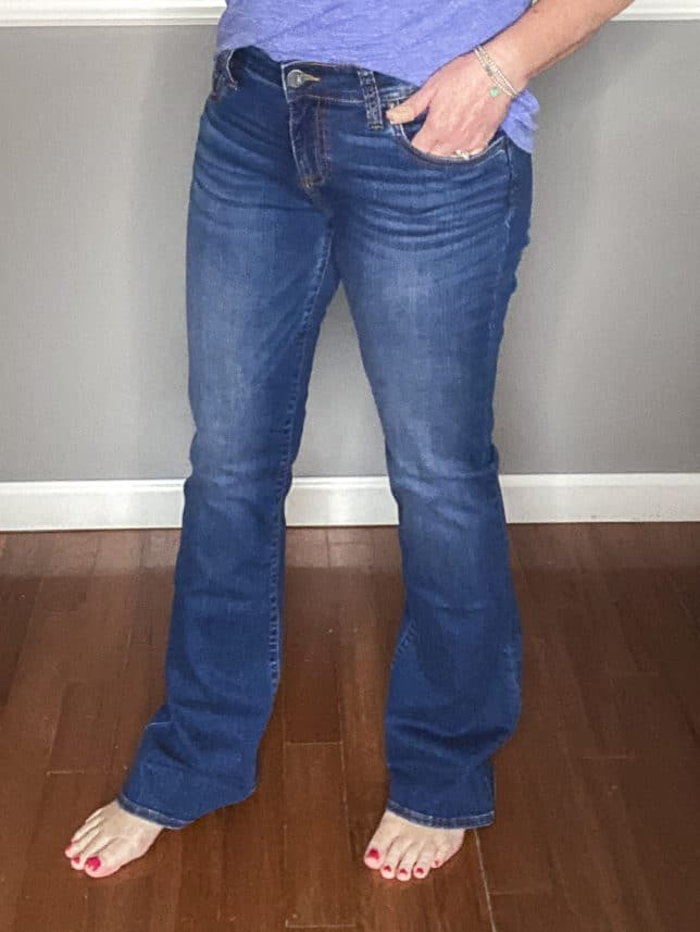 Fashion Blogger 50 Is Not Old showing a pair of flare jeans from Kut From The Kloth and a blue v-neck t-shirt