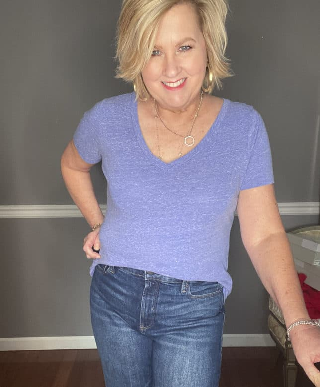 Fashion Blogger 50 Is Not Old wearing a pair of boyfriend jeans from Old Navy and a blue v-neck t-shirt