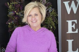 Fashion Blogger 50 Is Not Old wearing a lilac sweater