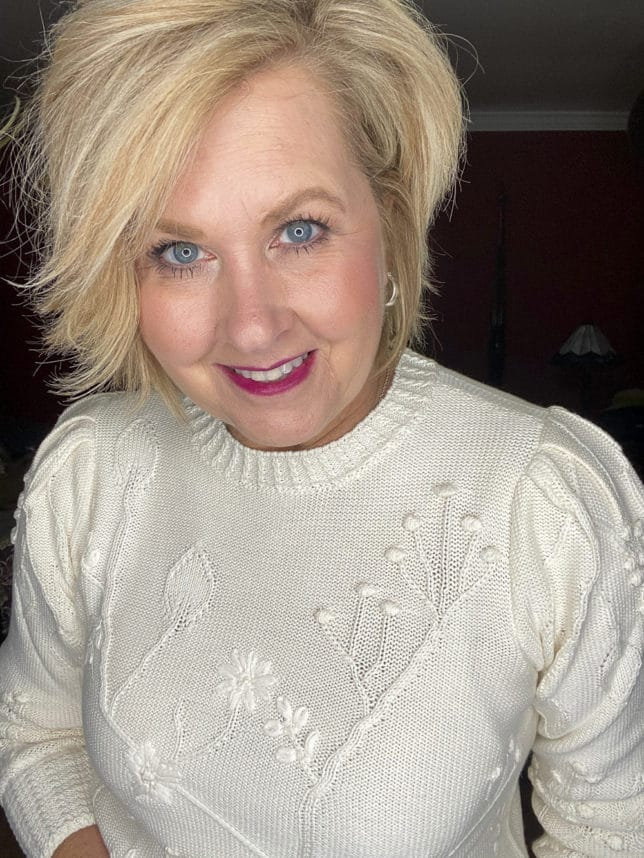 Fashion Blogger styling a crewneck floral embroidered white sweater from Loft