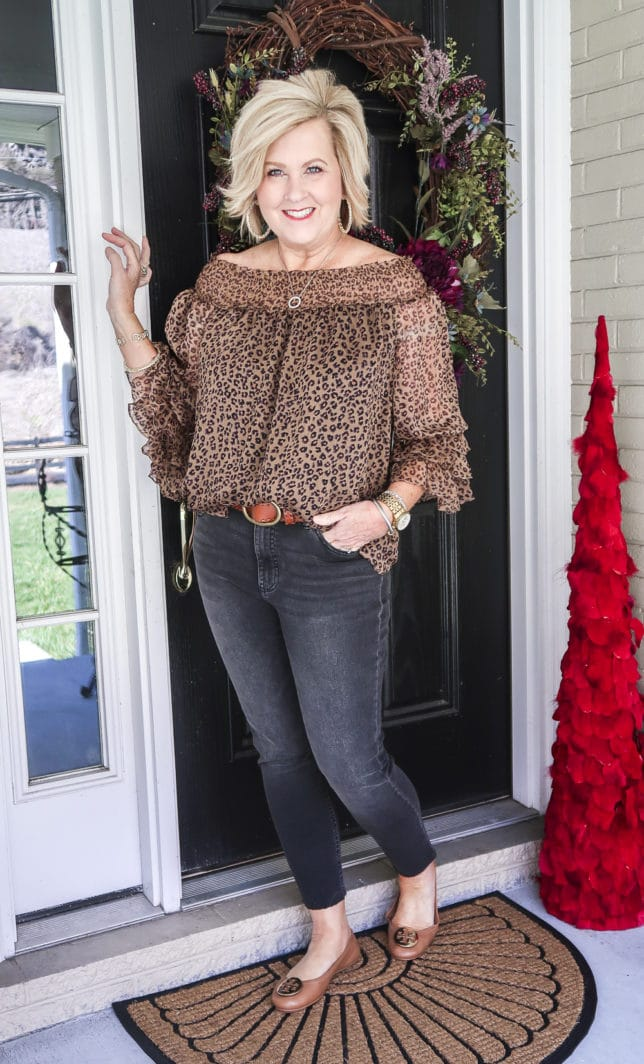 Fashion Blogger 50 Is Not Old wearing a sexy leopard print top and black jeans with brown ballet flats