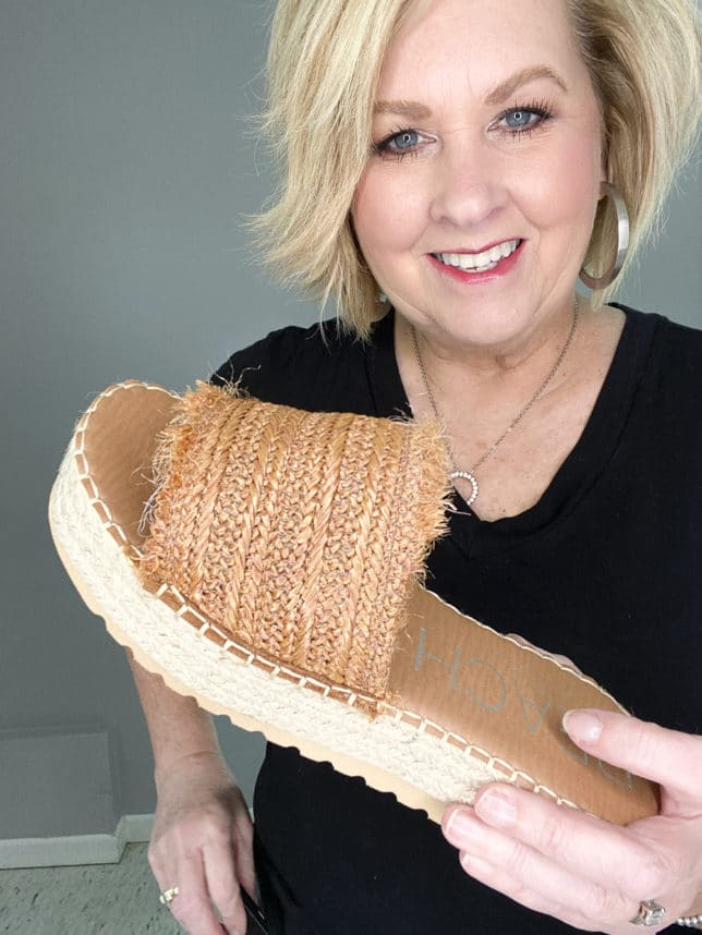 FASHION BLOGGER 50 IS NOT OLD HOLDING COGNAC FRAYED PLATFORM SHOES