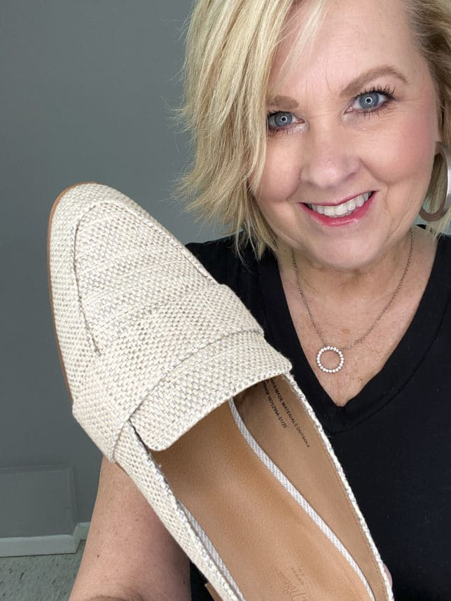 FASHION BLOGGER 50 IS NOT OLD HOLDING LINEN LOOKING MULES FROM TARGET