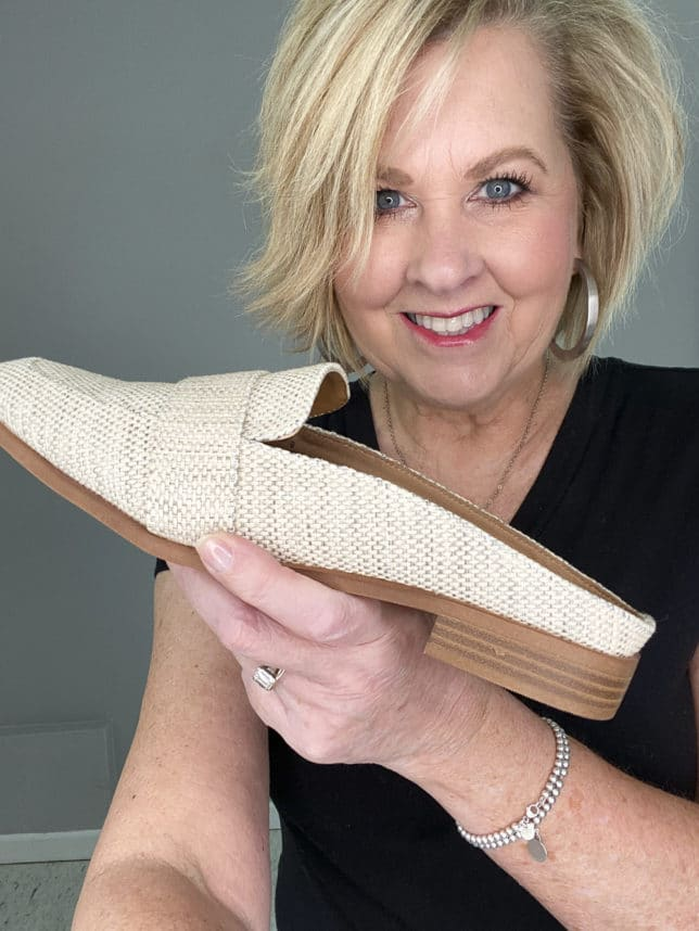 FASHION BLOGGER 50 IS NOT OLD HOLDING SUMMER LOOKING MULES FROM TARGET
