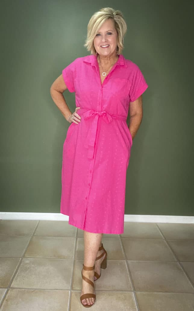 Fashion Blogger 50 Is Not Old wearing a fashionable bright pink eyelet dress from Walmart