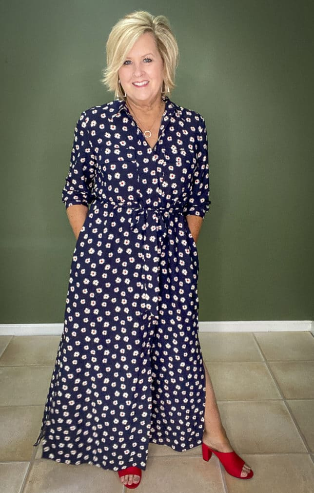 Fashion Blogger 50 Is Not Old wearing a navy dress with white daisies from Walmart