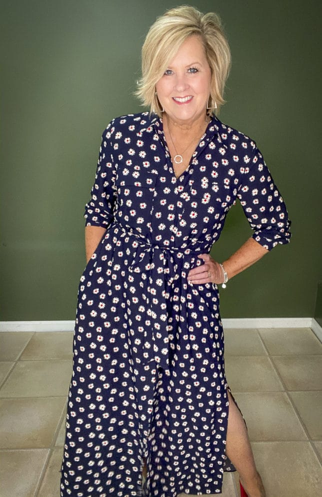 Fashion Blogger 50 Is Not Old wearing a stylish and affordable navy dress with white daisies from Walmart