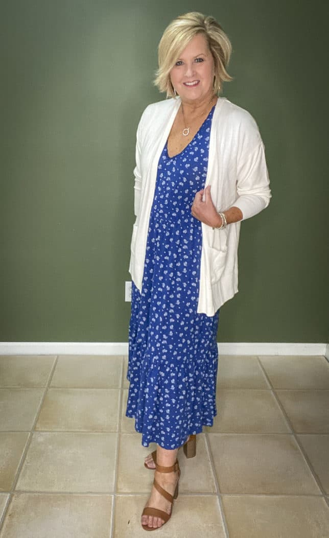 Fashion Blogger 50 Is Not Old wearing a white cardigan and a blue and white maxi dress from Walmart
