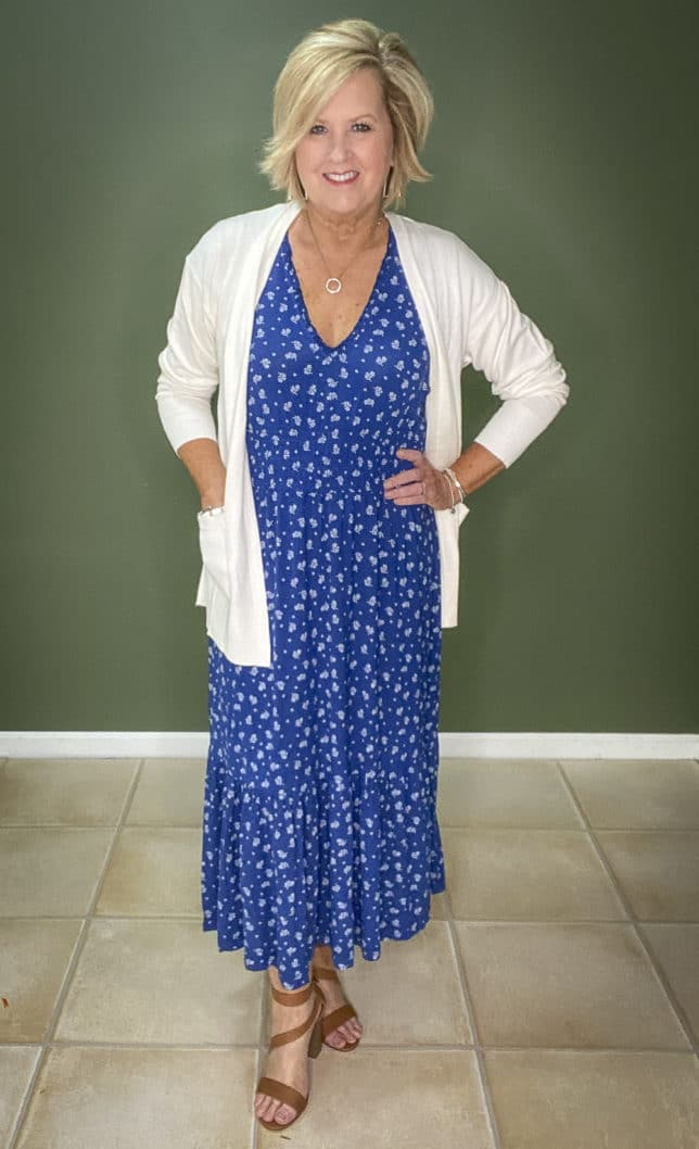 Fashion Blogger 50 Is Not Old wearing a white cardigan, a blue and white maxi dress, and brown sandals from Walmart