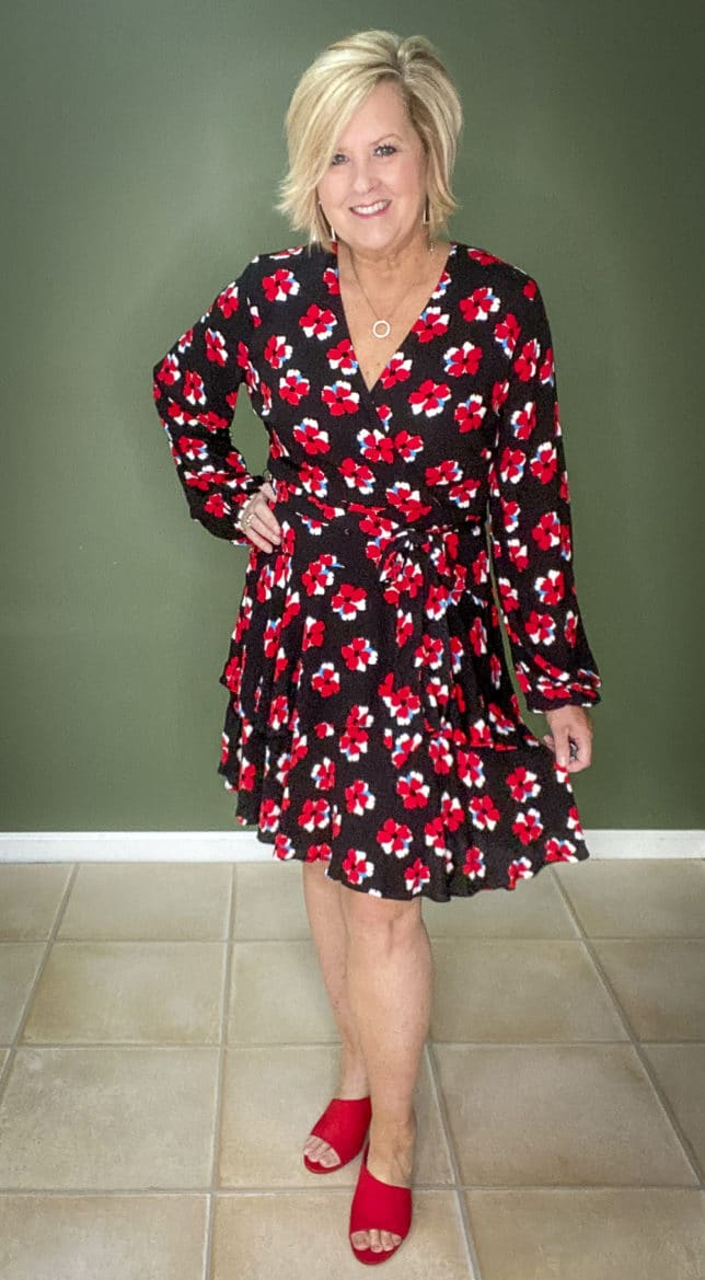 Fashion Blogger 50 Is Not Old wearing a flirty dress with bright red poppies from Walmart