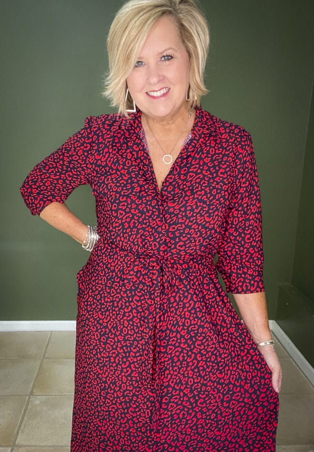 Fashion Blogger 50 Is Not Old wearing a stylish red and navy animal print shirt dress from Walmart