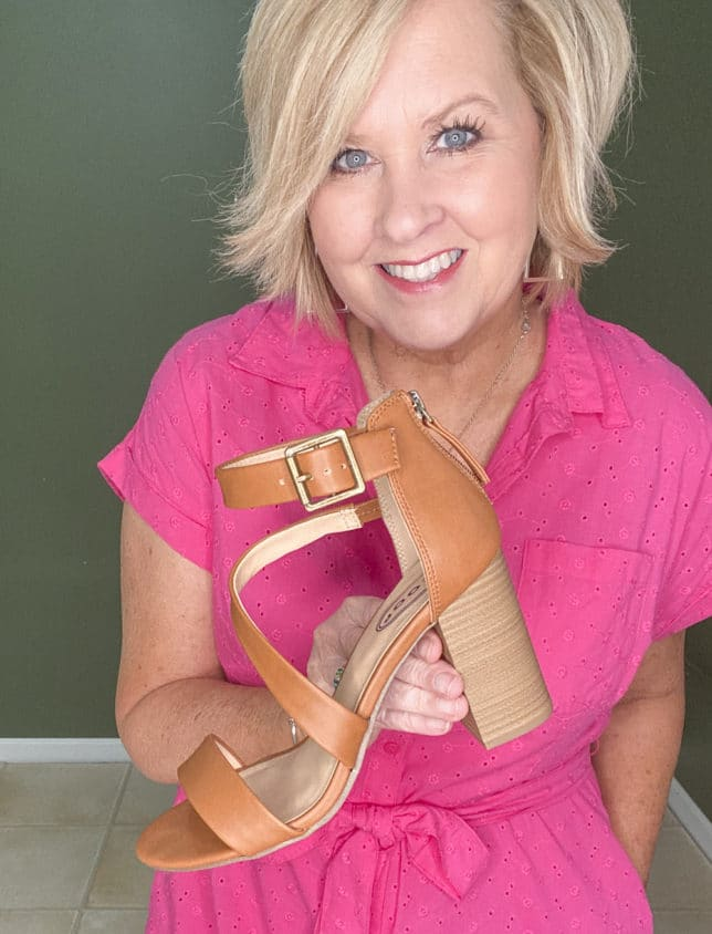 Fashion Blogger 50 Is Not Old showing a bright pink eyelet dress and brown block heel sandals from Walmart