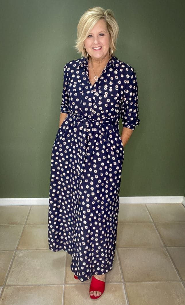 Fashion Blogger 50 Is Not Old wearing a fashionable navy dress with white daisies from Walmart