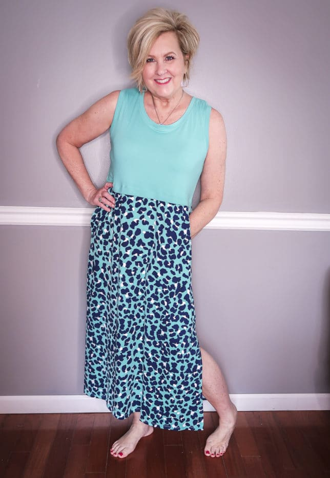 Fashion Blogger 50 Is Not Old is wearing a lagoon blue and animal print maxi dress