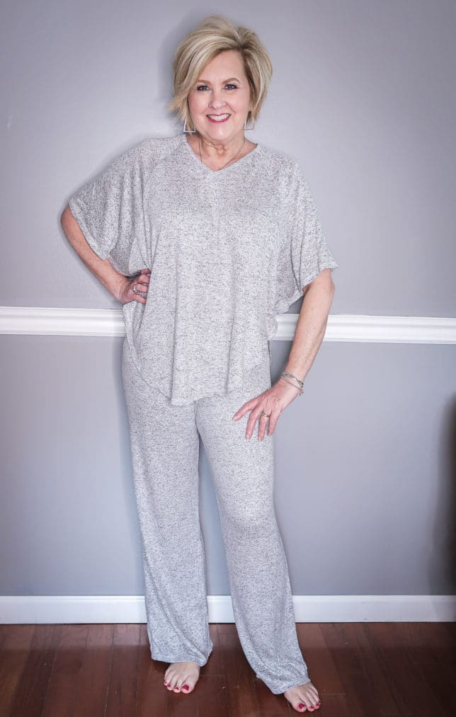 Fashion Blogger 50 Is Not Old is wearing a gray flounce loungewear pant set