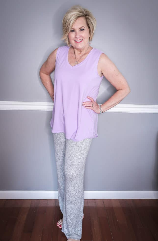 Fashion Blogger 50 Is Not Old is wearing a lilac tank top and a gray loungewear wide leg pant