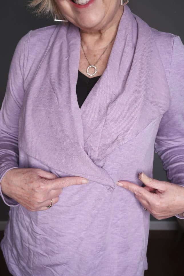Fashion Blogger 50 Is Not Old is wearing a black tank top with a lilac cardigan